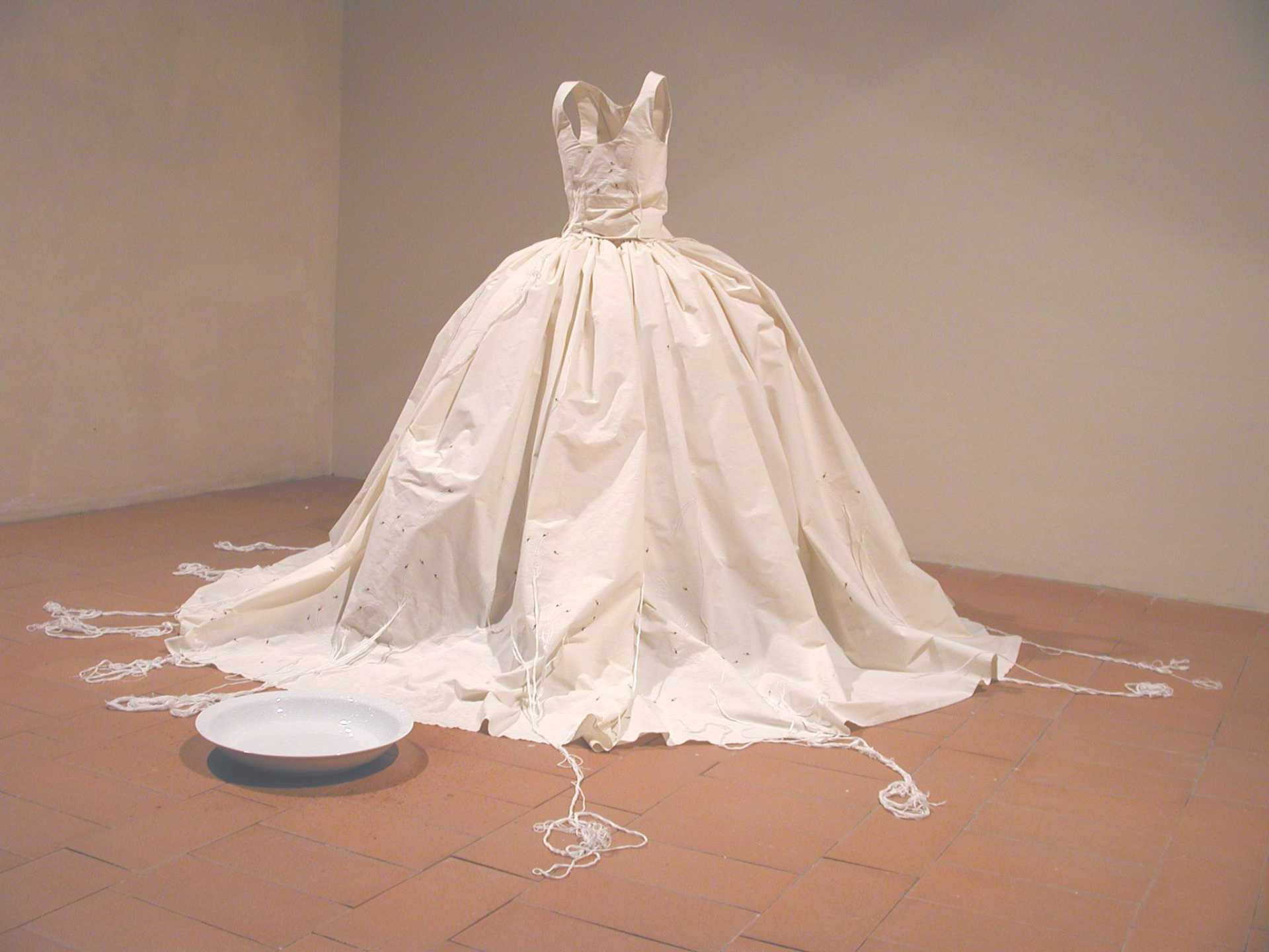 Post Performance Installation - Waiting at palazzo Fabroni in Pistoia, embroidered dress with long threads attached