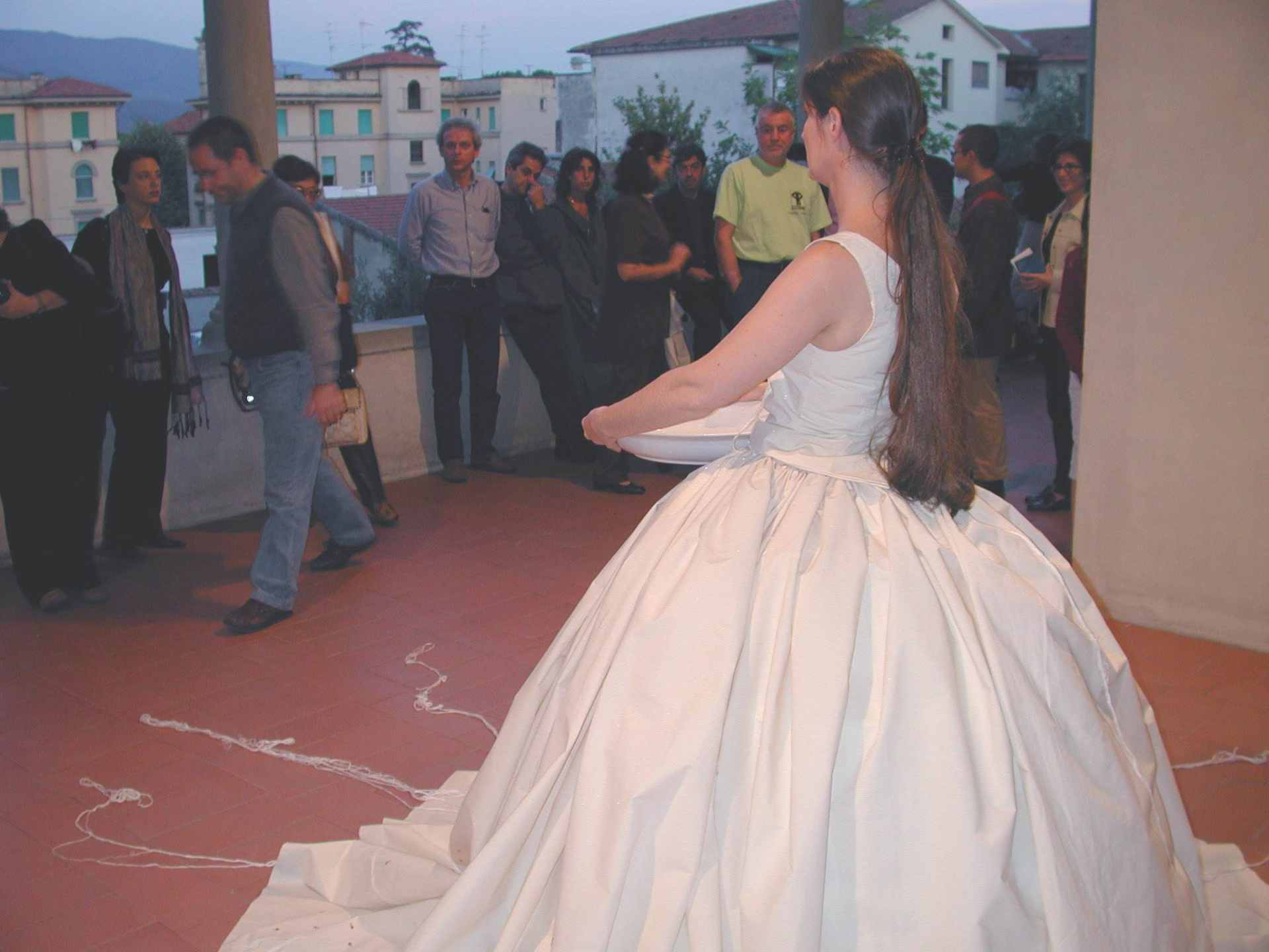 Performance Waiting at palazzo Fabroni in Pistoia, embroidered dress with long threads attached